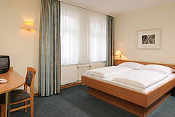 Simple but elegant double room at Hotel Allegra in Berlin